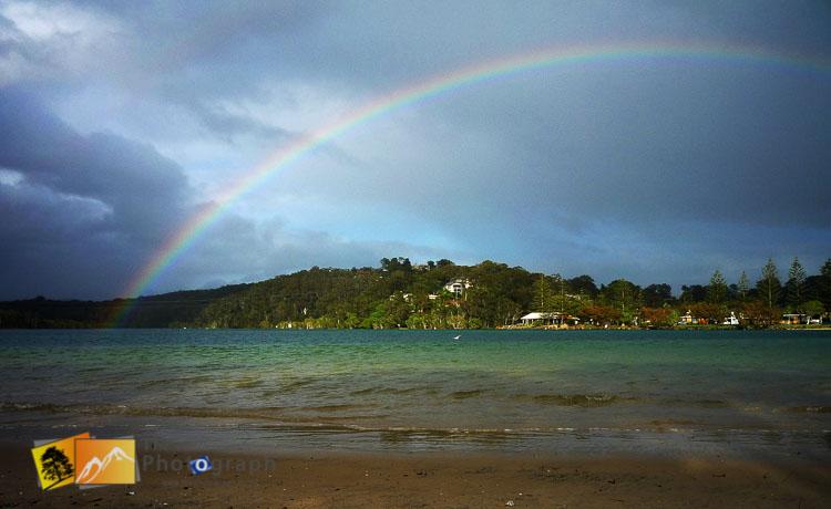 Rainbow over lake at Tallebududgera creek