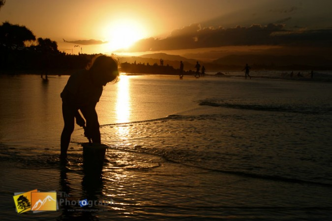 playing on the beach at sunset time