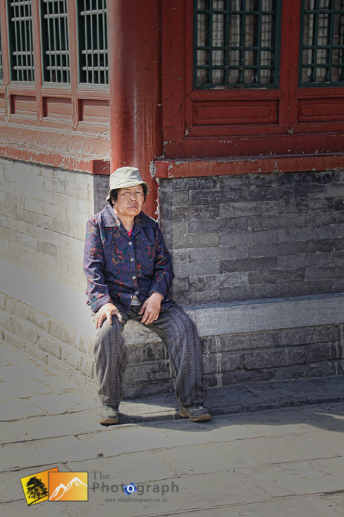 Old lady near the great wall of China