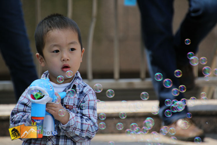 Kids blowing bubbles in Shanghai park China