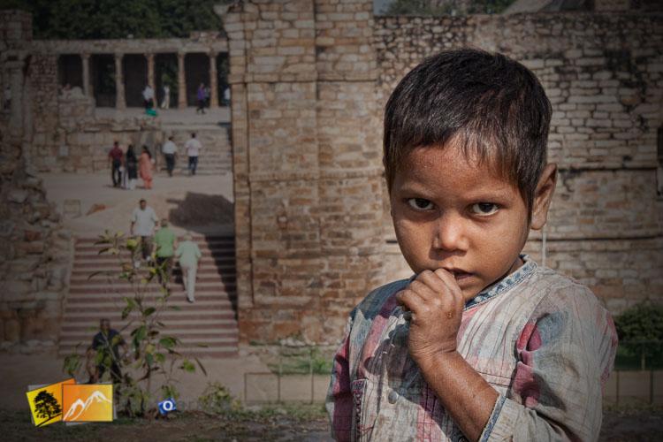 Beggar boy at Qutab Minor