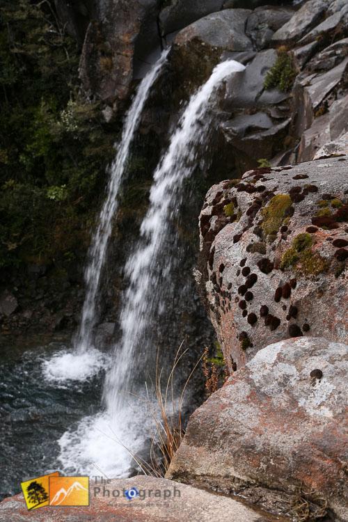 Small mountain waterfall.