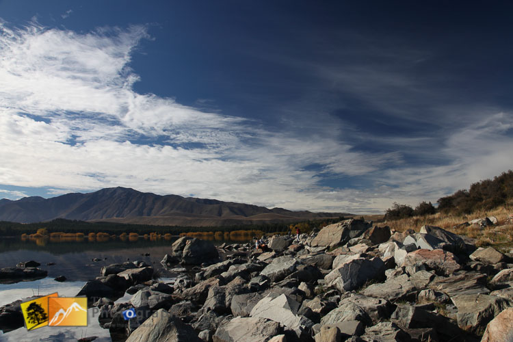 Rocky shore at lake Tekapo.