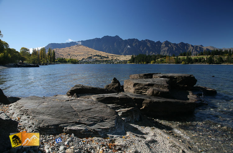 Rocky shore of lake Wakatipu with remarkables view.