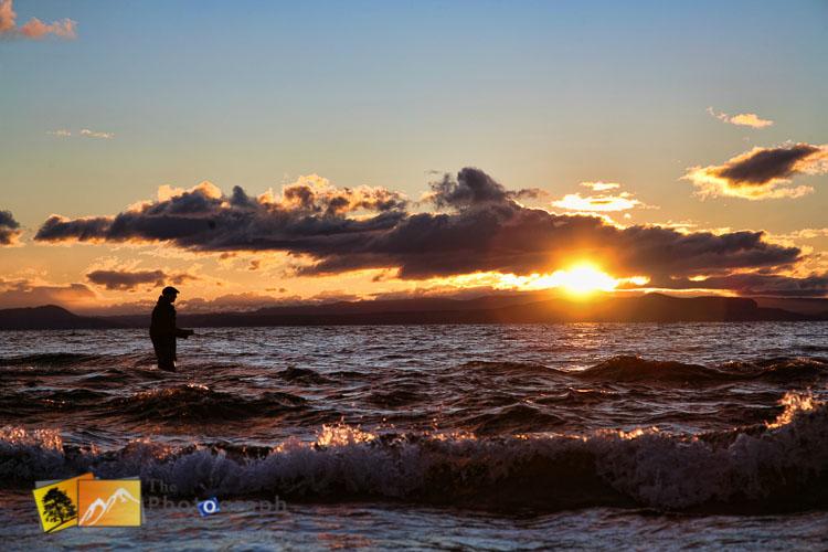 Fishing on Taupo lake at sunset.