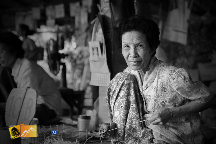 lady working in umbrella factory Chang Mai